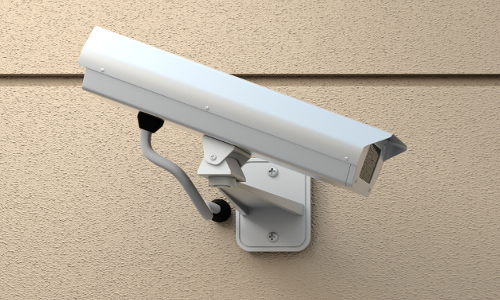 White security camera on a wall